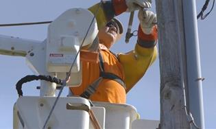 worker fixing power line